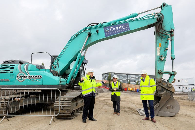 PM Boris Johnson with workers by Dunton Environmental digger