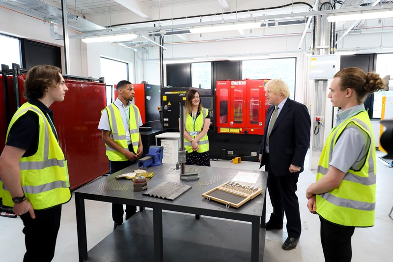 PM Boris Johnson and students within factory